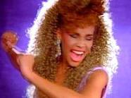 WHO LOVES ME Houston in the video clip for her 1987 smash hit I Wanna Dance with Somebody.