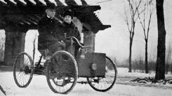 MAN OF EXTREMES Henry Ford and his wife in his first car.