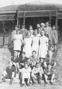 BRAVE FACES The children and staff at Coorah c.1942. Yvonne is first on the right in the girls' row.