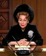 BOARDROOM BITCH Faye Dunaway as Joan Crawford in Mommie Dearest.