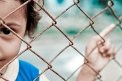 POLITICAL PRISONER A child behind Australian wire (Photo: Asylum Seeker Resource Centre)